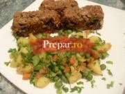 Rulada de carne tocata cu spanac si rosii cu garnitura de legume sote
